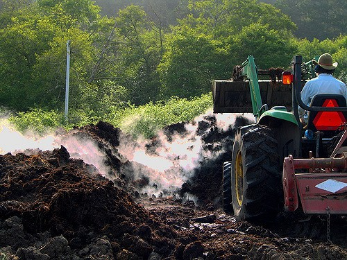 tractor turning compost piles