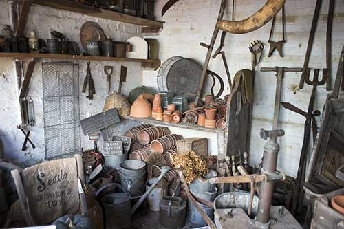 garden shed with tools and plant pots