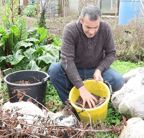 Tony O'Neill with compost ingredients