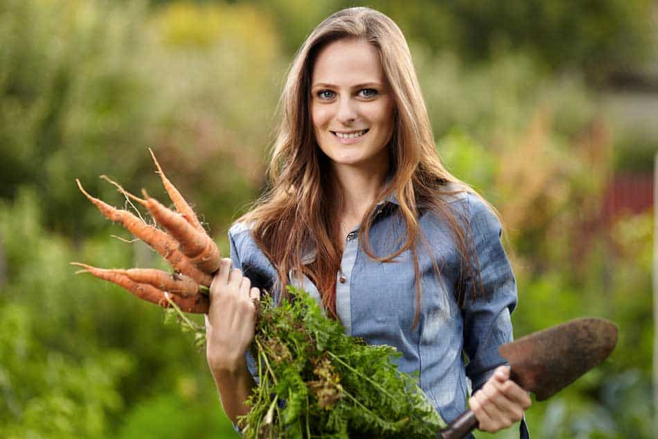lady with harvested carrots