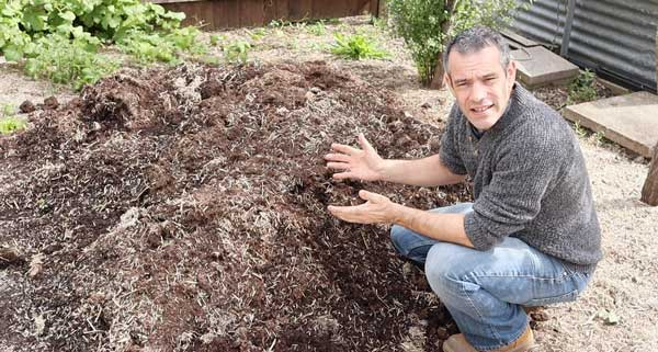 Tony O'Neill with a mound of compost
