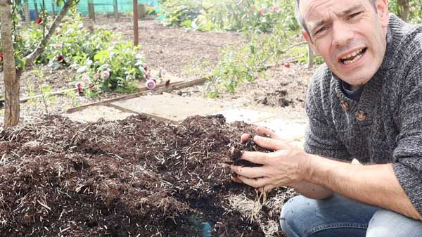 Tony O'Neill with hand full of compost