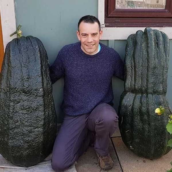 Picture of Tony O'Neill with two giant zucchini