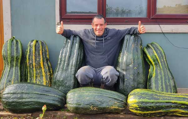 Picture of Tony O'Neill with giant zucchini's