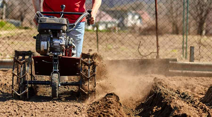 tilling soil with large tiller