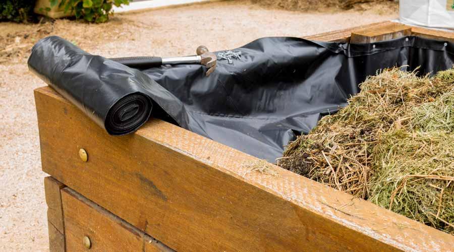 grass in compost bin