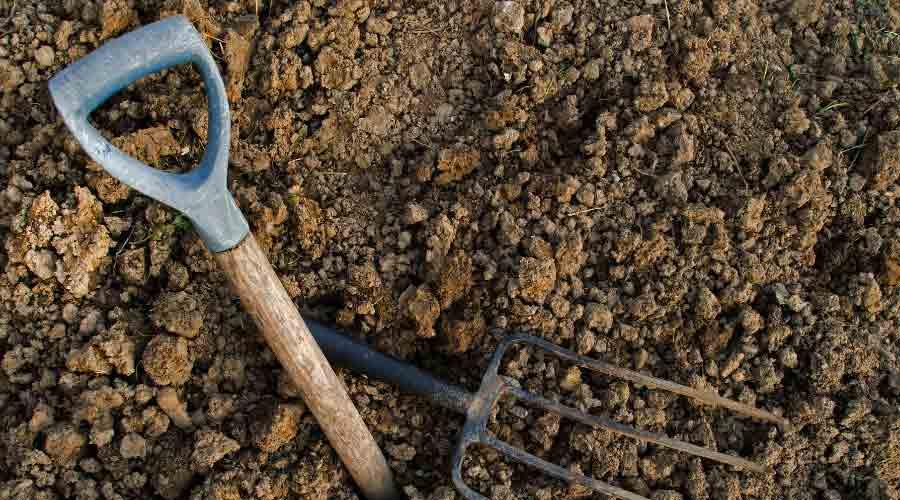 broken fork on clay soil
