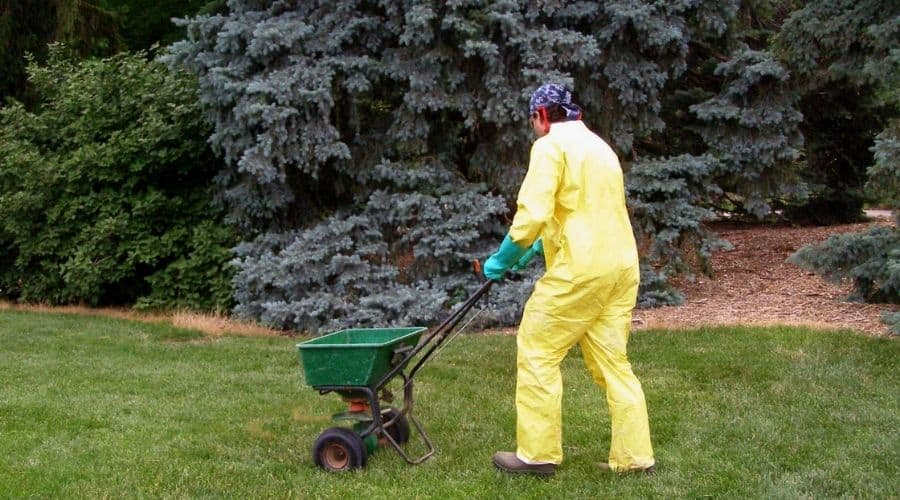 Picture of a Professional landscaper wearing protective suit