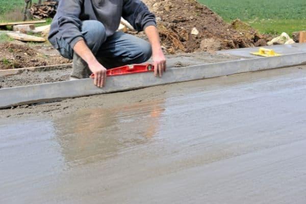 Picture of man making concrete slab flooring