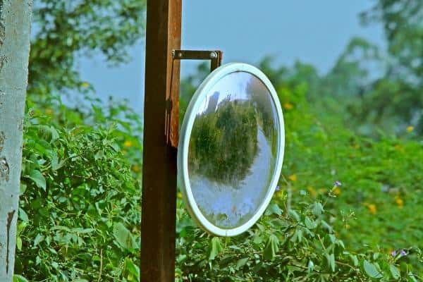 outdoor mirror on a wooden pole