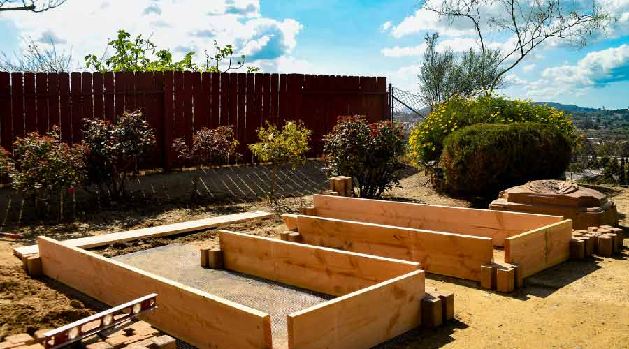 wooden raised beds being constructed