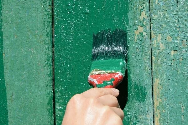 Picture of a hand repainting fences